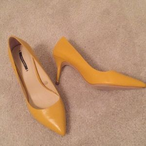 Canary yellow pointed-toe Zara heels